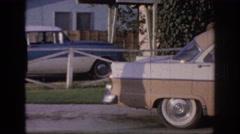 1967: soldier walks around car to enter house OKLAHOMA Stock Footage