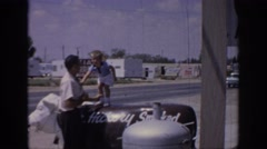 1967: father and son on the side of the road with boy standing  Stock Footage