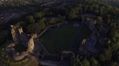 Long tilting aerial view of a castle in Dudley, West Midlands. Stock Footage