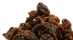 Raisins or dried grape turning on white background Stock Footage