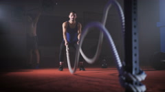 Fit young man holds rope in his hands and makes heavy rope training workout Stock Footage