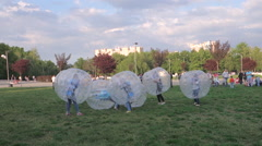 Attentive and courageous girls playing zorb Stock Footage