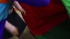 Kids crawling through play tunnel Stock Footage