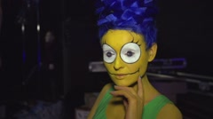 Woman in Marge Simpson make up Stock Footage