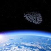 Looking at the asteroid approaching from space to Earth Kuvituskuvat