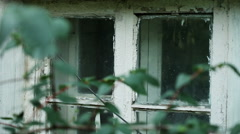 Old residential house. Wooden glassed window with cracked white paint on it. HD Stock Footage