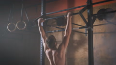 Young muscular athlete doing pull-up exercises Stock Footage