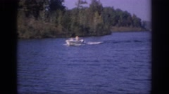 1966: boat sailing river people sitting beautiful scene green trees around Stock Footage