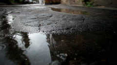 Russian town. Old city streets. Puddles on the paved path in the rain. HD Stock Footage