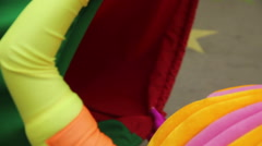 Animator holding play tunnel for kids crawling through it Stock Footage