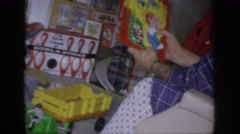 1966: lots of toys and christmas presents strewn about the floor SACRAMENTO Stock Footage