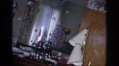 1966: family having a good christmas morning. SACRAMENTO CALIFORNIA Stock Footage
