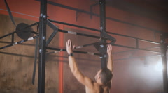 Strong man doing pull ups Stock Footage