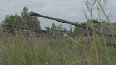 Self-propelled artillery unit in the stands. Military armored vehicles Stock Footage