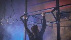 The athlete doing pull-up under the name of the butterfly Stock Footage