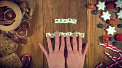 """4k Christmas Food from Above Composition of Scrabble words """"Merry Christmas"""" Stock Footage"""