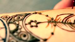 HD 1080 painting mehendi, henna closeup Stock Footage