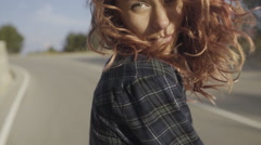 Sensual girl hipster with pink hair wearing a knit bra and shirt walking on the Stock Footage