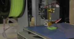 3d printer in process. It makes pieces for equipment with green plastic Stock Footage