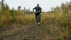Athlete skyrunning running uphill Stock Footage