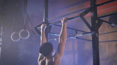 Muscular man doing kipping pull ups Stock Footage