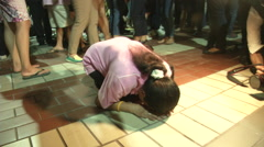 Women Prostrates Over Death of King of Thailand Stock Footage