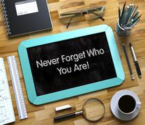 Never Forget Who You Are Concept on Small Chalkboard. 3D Stock Illustration