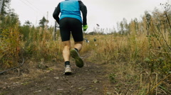 Man athlete skyrunning running uphill Stock Footage