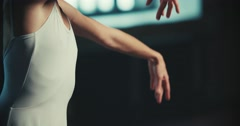 Beautiful girl dancer performs elements of classical ballet in the loft design Stock Footage