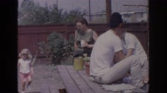 1967: a group of people gathered in a backyard for a barbecue OKLAHOMA Stock Footage
