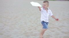 The Boy Launches the Paper Plane Stock Footage