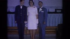 1967: bride, groom and father posing for wedding photos. OKLAHOMA Stock Footage