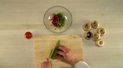 Chef skillfully slicing tomato. First person view Stock Footage