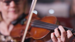 4K Symphony orchestra during a performance with close up on violinist Stock Footage