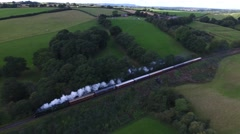 Aerial tracking shot of the Flying Scotsman steam train. Stock Footage