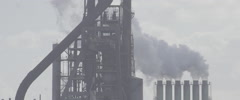Ijmuiden coal and steel industy factory. Slomo with lots of smoke. Raw Stock Footage