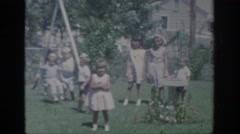 1967: children playing together on the playground OKLAHOMA Stock Footage