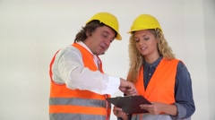 Senior engineer teaching to young cute female trainee Stock Footage