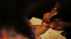 Woman paints mehendi art on the palm Stock Footage