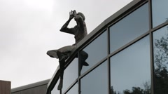 Man On The Roof Modern Sculpture Stock Footage