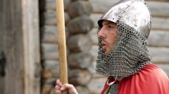Knight in armours with spears guards the fortress and sings a song Stock Footage