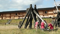 People near old wooden catapults in Kyivan Rus park, Kopachiv village Stock Footage