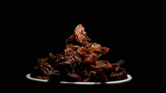 Raisins or dried grape in a bowl on black background gyrating Stock Footage