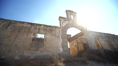 Old silk factory ruin with the sun and a lens flare Stock Footage