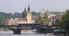 Red trams on Legion Bridge in Prague Stock Footage