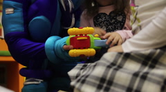 Animator with children collect toy plane from constructor Stock Footage