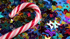 Christmas candy lying on the small stars Stock Footage