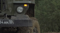 Army Staff Russian truck driving on dirt road. Dirty armored vehicle Stock Footage