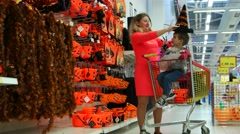 Shopping in a large supermarket on Halloween, mother and son preparing for All Stock Footage