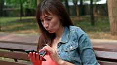 A young woman takes a Smartphone Stock Footage